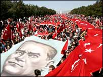 Demonstrators march through Ankara with a huge banner of Ataturk