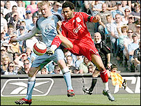 Liverpool winger Jermaine Pennant (right) steals in ahead of Man City's Michael Ball (left) but saw his shot saved