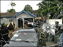 Cracked window of a truck carrying election material, that was shot at by assailants seen on arrival in Lagos from Abuja