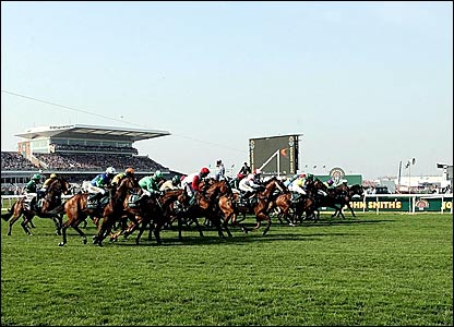 The runners and riders set off on the Grand National