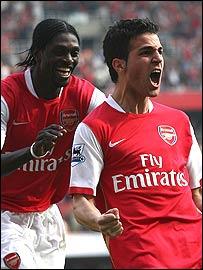 Adebayor congratulates Fabregas, right, on his winner