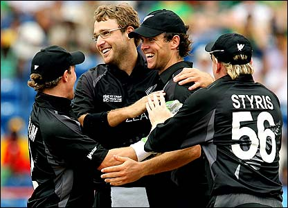 Daniel Vettori is congratulated by his New Zealand team-mates