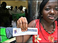 Voter shows her slip before casting her vote in Port Harcourt
