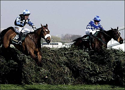 Silver Birch (left) and Slim Pickings jump the last in the Grand National