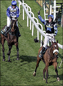 Silver Birch (front) wins the Grand National with Slim Pickings in third