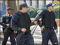 Moroccan police patrol the area hit by the bombers