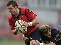 Mossie Lawlor is tackled by Matthew Watkins
