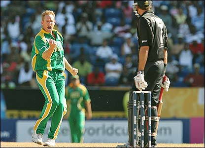 Shaun Pollock celebrates after removing Fleming