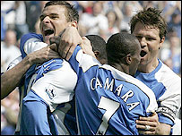 Wigan striker Emile Heskey (second left) is congratulated by Lee McCulloch (left), Henri Camara (second right) and Arjan De Zeeuw after his opening goal against Tottenham