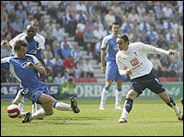 Dimitar Berbatov (right) slots in for Tottenham as he equalises to make it 1-1 in the game against Wigan