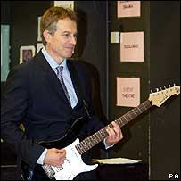 Tony Blair playing guitar