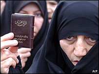 An Iranian woman holds a copy of the Koran (file)