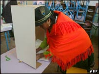 A woman votes in  Cangahua, north of Ecuador's capital Quito