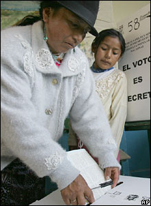 A woman votes in Calderon, north of Quito