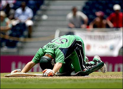 Eoin Morgan lies on the floor after being run-out