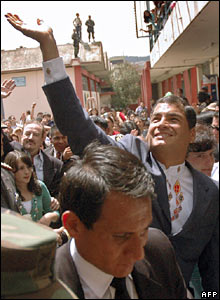 Rafael Correa arriving to cast his vote in Quito, surrounded by supporters and tight security