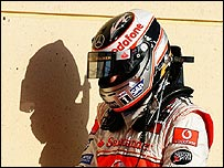Fernando Alonso walks away from his car at the end of an unhappy Bahrain Grand Prix
