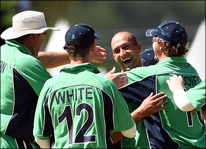Ireland's Andre Botha is mobbed by his team-mates