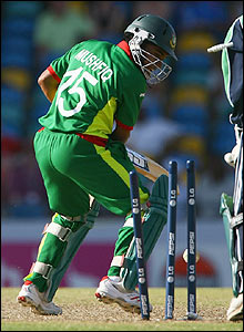 Mushfiqur Rahim is bowled by Kyle McCallan