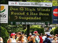 An information screen gives the crowd some bad news at the Verizon Heritage