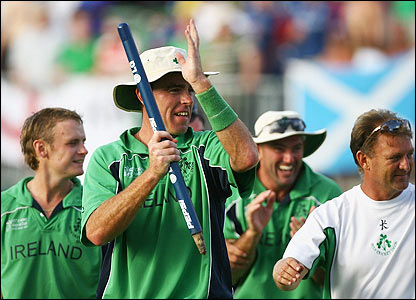 Johnston and his players salute the large army of Irish fans after the victory