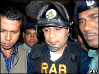 Tarique Rahman, son of former Prime Minister Khaleda Zia is led away by police