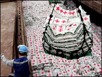 File photo: Bags of fertiliser aid are loaded on to South Korean ships for the North