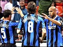 Adriano (right) celebrates his goal