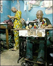 Tailors in Lagos use foot-pedalled sewing machines and sew by hand to enable them to work without electricity
