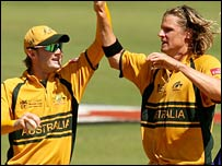 Nathan Bracken (right) is congratulated by Michael Clarke