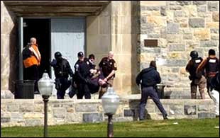 Police carry wounded from building