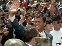President Rafael Correa waves after referendum in Ecuador