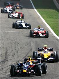 Heikki Kovalainen's Renault follows Mark Webber's Red Bull in the heat of the midfield battle in Bahrain