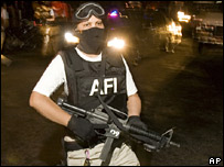 Mexican policeman on anti-drugs operation at night