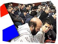 Dutch Muslims praying and the Dutch flag