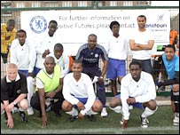 Ashley Cole and Geremi line up with the Postitive Futures group