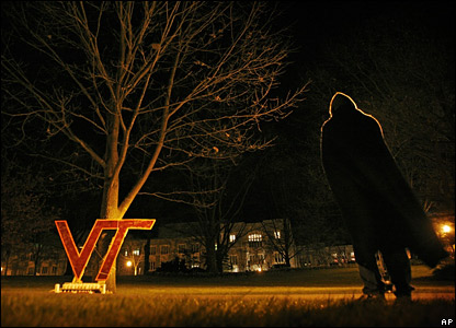 Student standing by cardboard sign of VT