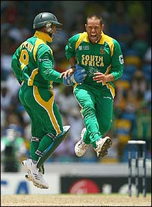 South Africa's keeper Mark Boucher congratulates Andrew Hall