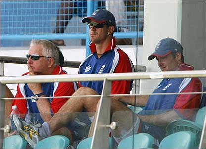 England's coach Duncan Fletcher watches from the dressing room alongside Pietersen and Strauss