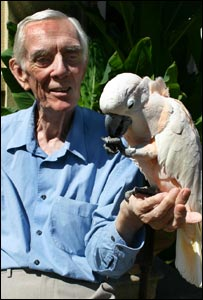 Mike Reynolds with Ollie, a Moluccan Cockatoo: Picture Paradise Park