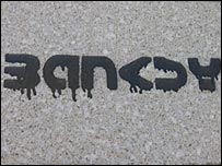 Banksy tag with running paint