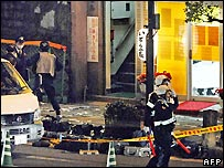 Police investigate the scene of the shooting in Nagasaki
