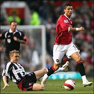 Cristiano Ronaldo escapes from Sheffield United's Derek Geary