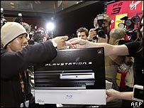 A happy customer buying his PS3 in London last month