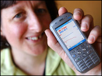 Dr Alison Marshall checks her heart rate on her mobile. Picture courtesy of Leeds University.