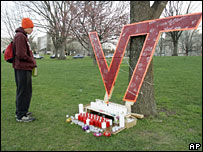 A student looks at a makeshift memorial to the students who were killed