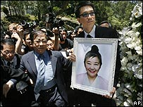 Nina Wang's godson Anthony Cheung holds a picture of her after a cremation ceremony in Hong Kong - 18/04/07