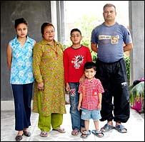 Nepalese policeman Sushil Kumar Khanal with his family today