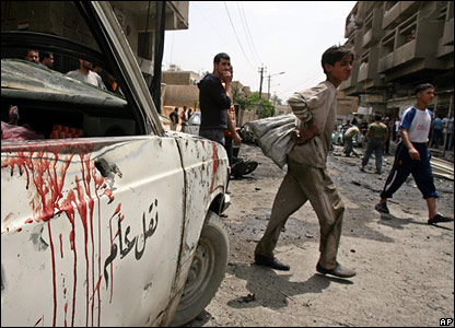Blood on the door of a car at Karrada site