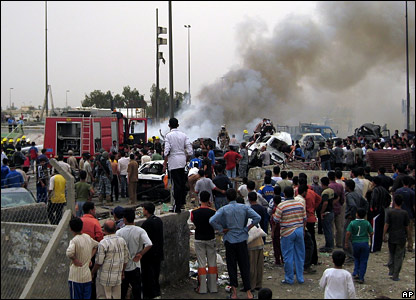 Smoke rises from the bomb in the Sadr district
